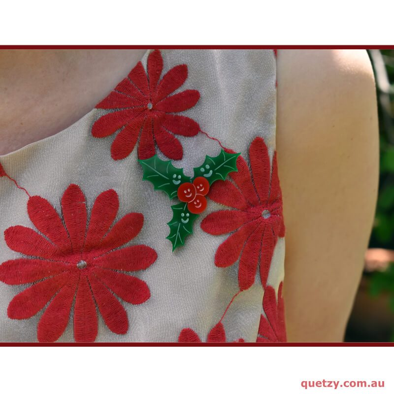 Happy 'Holly' Day Christmas themed brooch as worn on a dress.