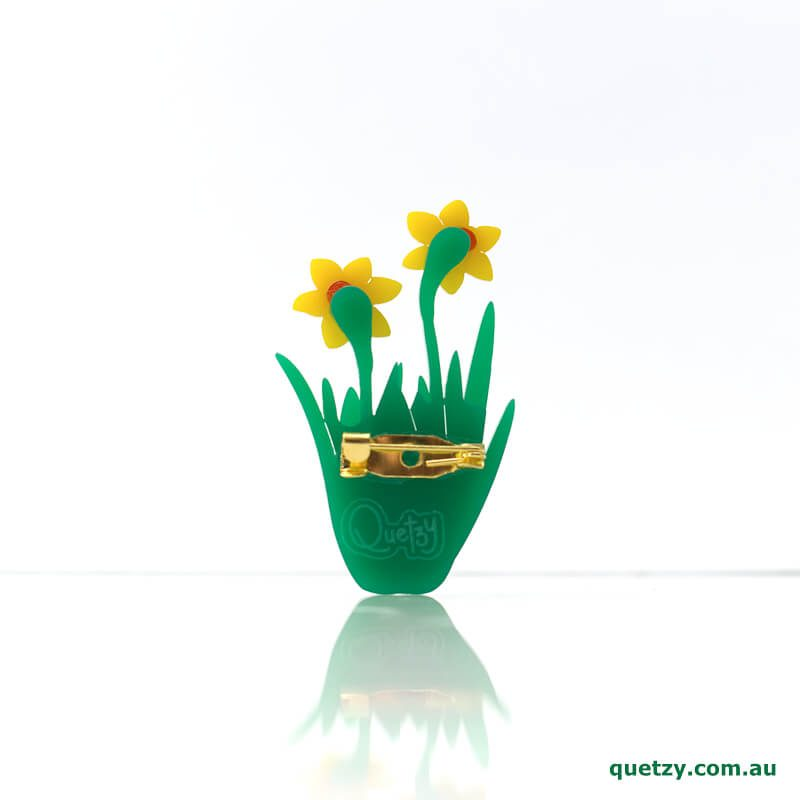 Daffodil acrylic brooch. Designed, laser cut and handmade by Quetzy.