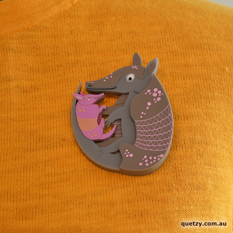Amouradillo acrylic brooch. Designed, laser cut and handmade by Quetzy.