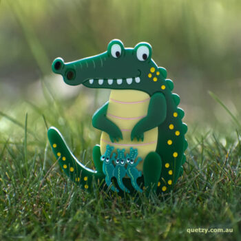 Crocodillius acrylic brooch. Designed, laser cut and handmade by Quetzy.