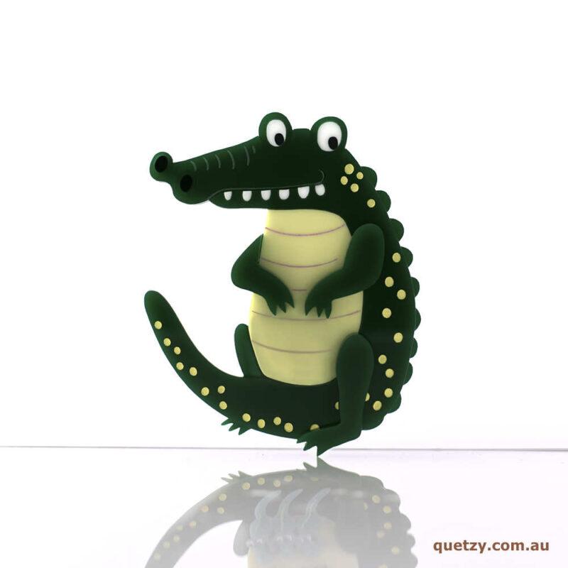 Crocodillius acrylic brooch. Designed, laser cut and handmade by Quetzy.