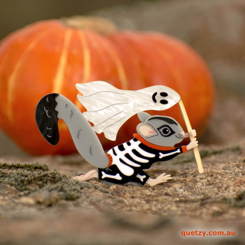 Spooky Squirrel Glider acrylic brooch. Designed, laser cut and handmade by Quetzy.
