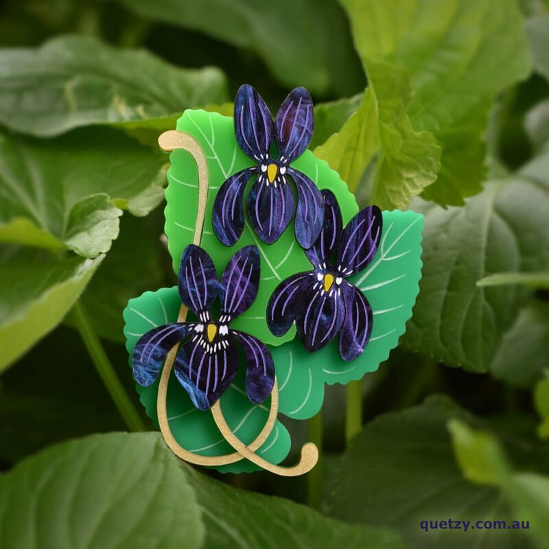 Cluster of Violets. A botanical themed acrylic brooch, designed and handmade by Quetzy.