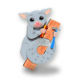 Acrylic brooch of a Brushtailed possum building a nest box. Created and designed by Quetzy